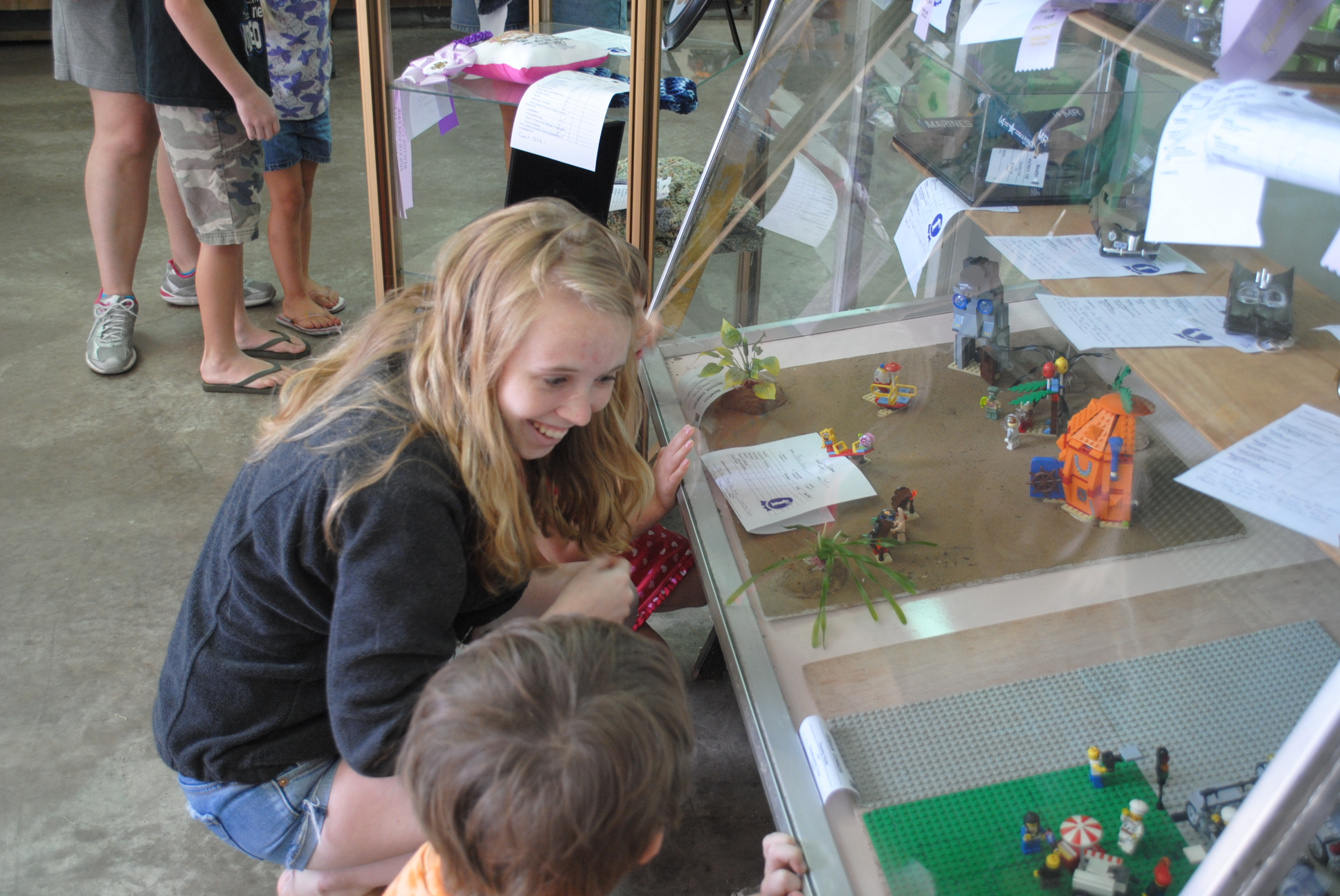 Jr. Leaders at the Newton County Pun'kin Vine Fair explain exhibits to Head Start kids